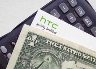 Логотип HTC на фоне калькулятора и долларовой банкноты // 4HTC.ru